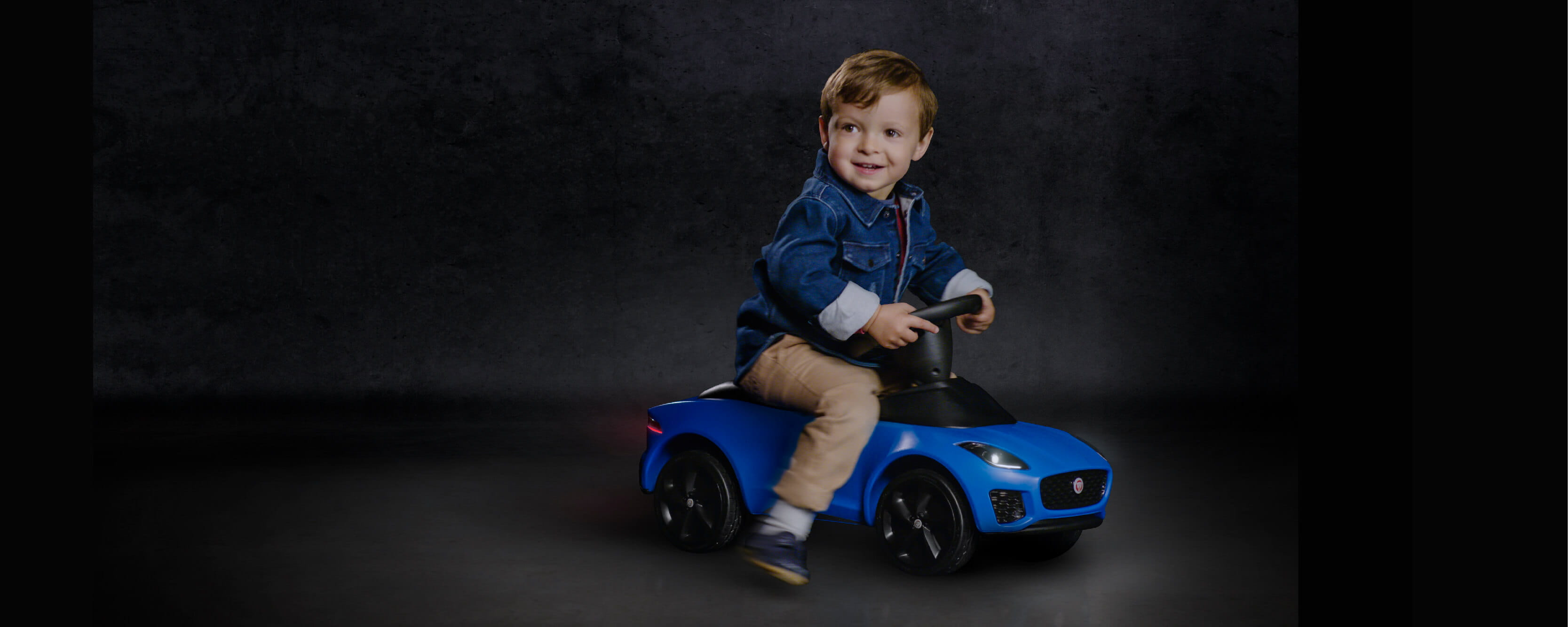 Child On A Mini Jaguar